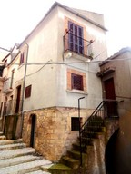 Two bed stone town house near swimming pool and lake.
