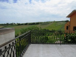 Stone built, countryside property with sun terrace, garden and garage overlooking rolling green hills.