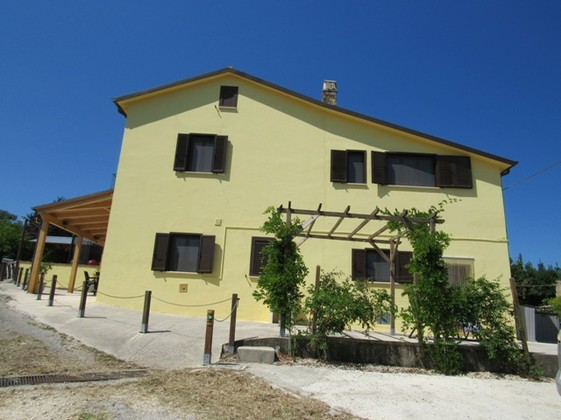 Hilltop, 300sqm stone farmhouse overlooking green vineyards with a distant sea view, completely renovated with barn.
