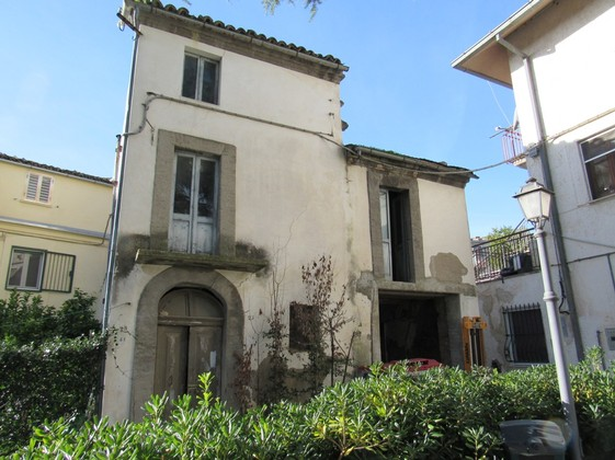 100 year old, original condition, stone town house in the center of a lively village.