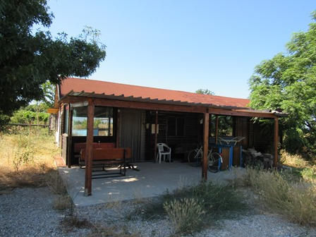 Detached, wooden house with 1 bed, 1500sqm of land 3km to the beach in an isolated location.
