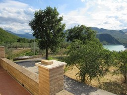 Finished, stone house, with lake and mountain view and 1000sqm of olive grove in an easily accessible location.1