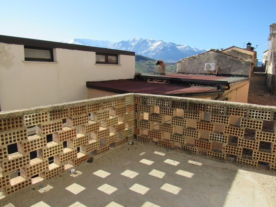 140sqm, stone, town house with 5 bedrooms and mountain views.
